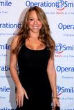 Mariah Carey shows cleavage in low-cut black dress at 5th Annual Operation Smile Gala in New York City