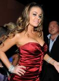 Carmen Electra pictures cleavage red dress 6th Annual Leather and Laces Celebration Tampa