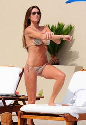 Rachel Uchitel - Tiger's Mistress Relaxes Poolside